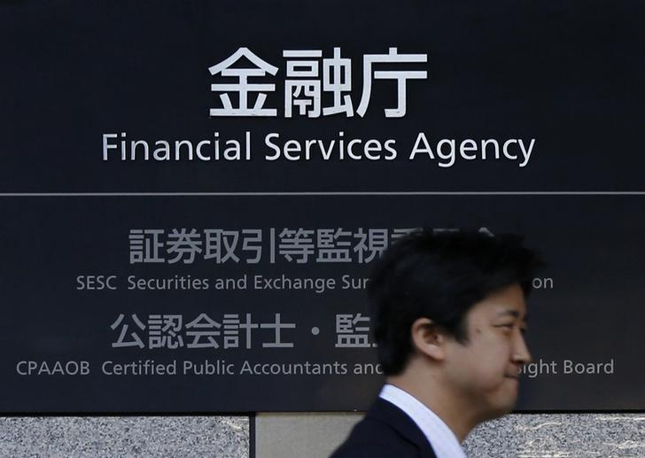 man walks by Japan's Financial Services Agency